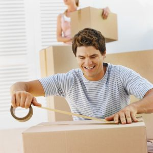 Couple moving house --- Image by © Royalty-Free/Corbis