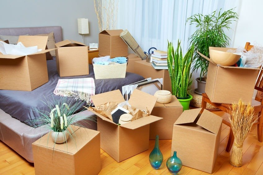 45284842 - moving boxes in new house. real estate concept.
